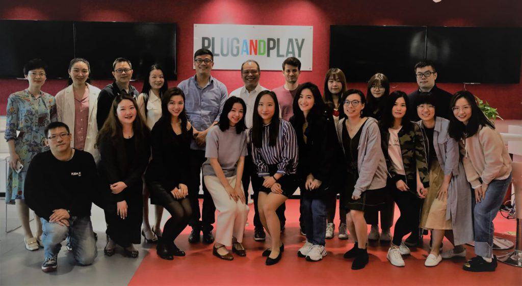 Jojo Flores (center with white shirt) with the Plug & Play China team in 2019. Photo courtesy of Plug & Play.